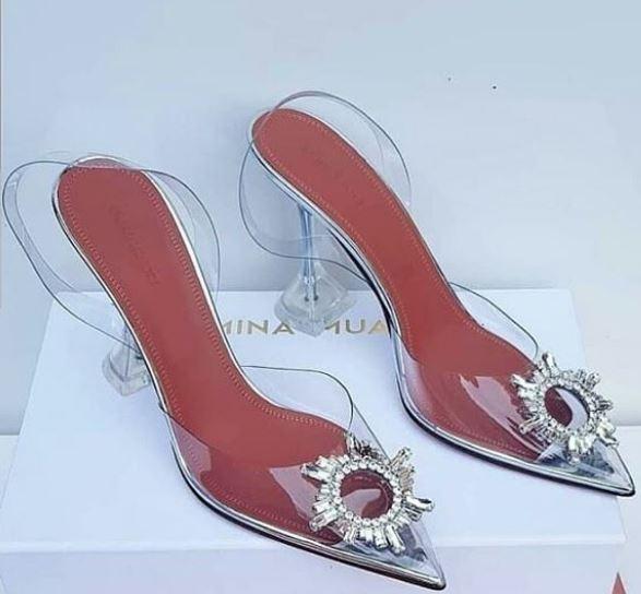 "Irene Uwoya Rocking Amina Muaddi glass""Begum"" slingbacks Zenye Thamani Ya USD 895"